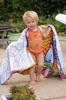 Girl in a beach towel after swiming