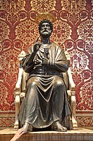 Bronze statue of St. Peter standing in St. Peter's Basilica. It is believed that touching the right foot bestows a blessing. 2006. Vatican. Rome. Lazi...