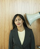 Businesswoman being yelled at through megaphone