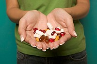 Close up of woman´s hands holding vitamins