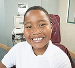 African boy smiling in dentist's chair