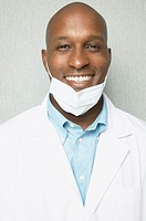African male dentist smiling