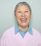 Close up of senior Asian woman laughing