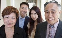 Asian family smiling indoors