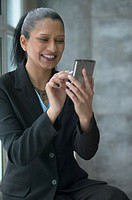 African businesswoman smiling and using PDA