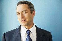 Studio shot of Hispanic businessman smiling