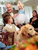 Multi-generational family and dog in kitchen