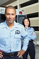 African male paramedic with co-worker in background