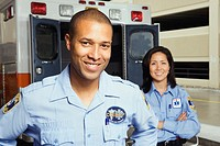 Portrait of paramedics in front of ambulance
