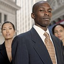 African businessman with businesswomen in background