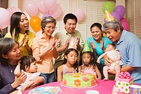 Multi-generational Asian family celebrating birthday