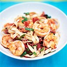 Ribbon pasta with tomatoes and shrimps