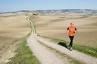 Italy, Tuscany, man jogging