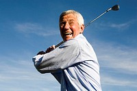 Senior adult man holding golf club