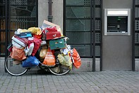 Bike full of bags, parking on a street