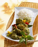 Curried chicken with Thai basil, peppers and rice