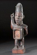 Wooden figure, African, 1890-1910 Carved wooden statue with upraised arm, a container for the nkisi force  Made by the BaKongo people of west-central ...