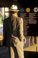 A business man stands waiting for a Metro rail