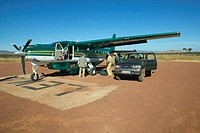 Airplane on landing strip, Africa