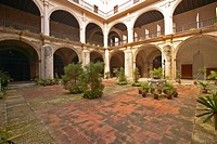 Centuries-old arches and courtyard of a colonial building in Havana