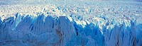 Panoramic view of glacier melting as it falls into water