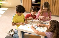 Portrait of kids playing a puzzle