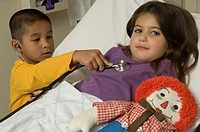 Portrait of young boy and girl in hospital