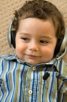 Portrait of a little toddler wearing headphones