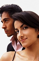 Close up portrait of an attractive Hispanic couple in formal clothing