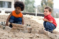 Portrait of little boys playing outdoors