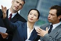 Business associates, woman in foreground gesturing