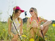 Young female golfers laughing