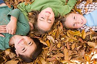 Girls lying on leaves