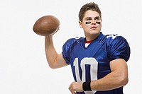 American football player throwing ball