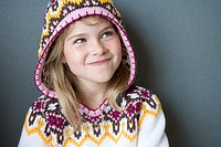 cheeky girl in winter pullover with hood