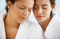 Two Women with Closed Eyes in Bathrobes