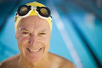 Senior Man Adjusting Swim Goggles (thumbnail)