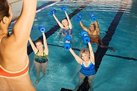 Senior Women Exercising in Swimming Pool