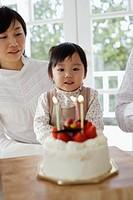 Little Girl Making a Birthday Wish