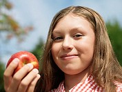 Pre-teen Girl Eating Apple