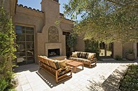 Sofas in Front of Outdoor Fireplace on Patio