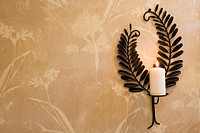 Candle Burning on Sconce