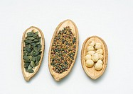Pumpkin seeds, sprouting seed mix, and lotus seeds in dried husks
