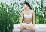 Woman sitting, meditating