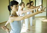 Yoga class standing in shiva posture