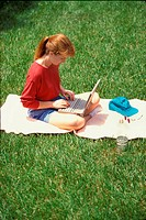 Woman outdoors with laptop #486