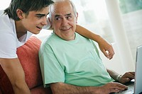 Grandfather and Teenage Boy with Laptop