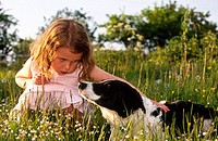 Little girl with dog. Öland. Sweden.