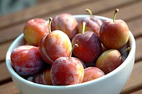 Close-up of plums in a fruit bowl