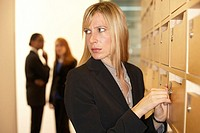 Close-up of a businesswoman unlocking a locker